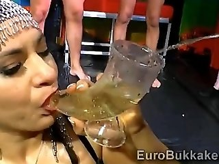 Euro Pin up beauty gets completely covered with golden water