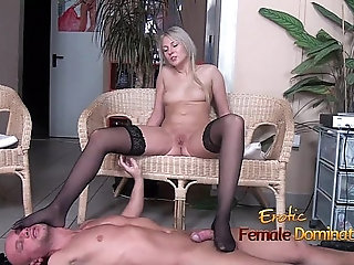 Stockinged footjob from a pantyless blonde