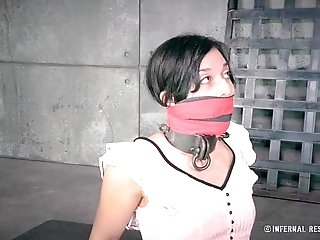 Petite Brunette in Metal Bondage
