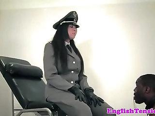 Uniformed mistress whipping black sub